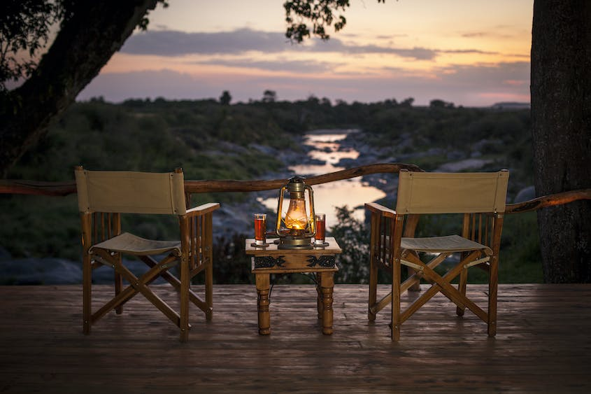 Have a sundowner—and maybe catch some of the Great Migration—at Asilia's Rekero Camp.