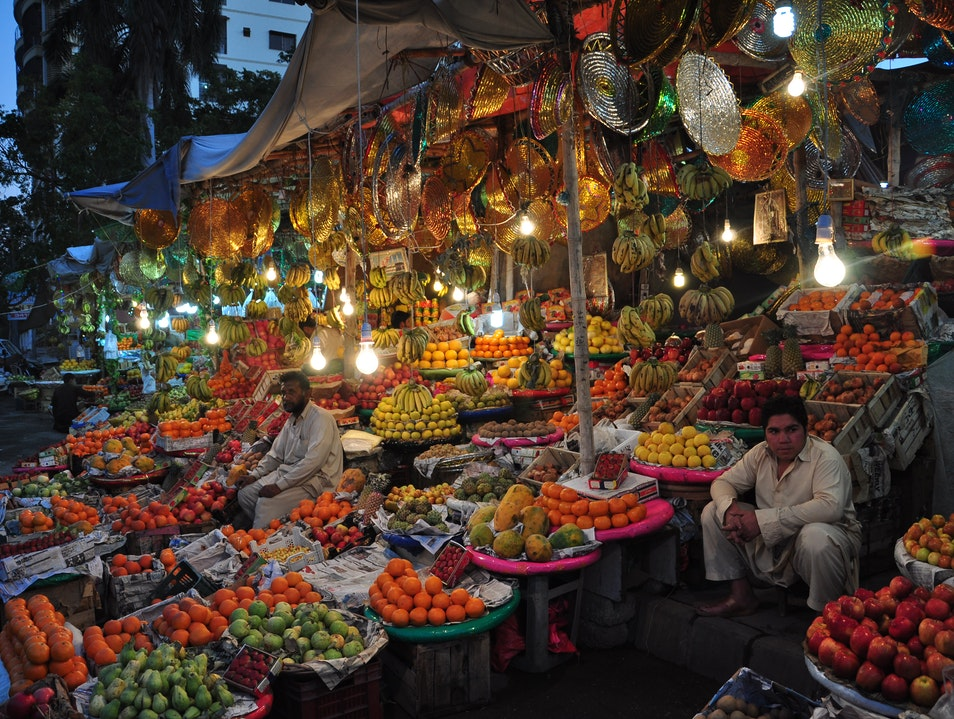 Fancy fruit vendor on a sidewalk Karachi  Pakistan