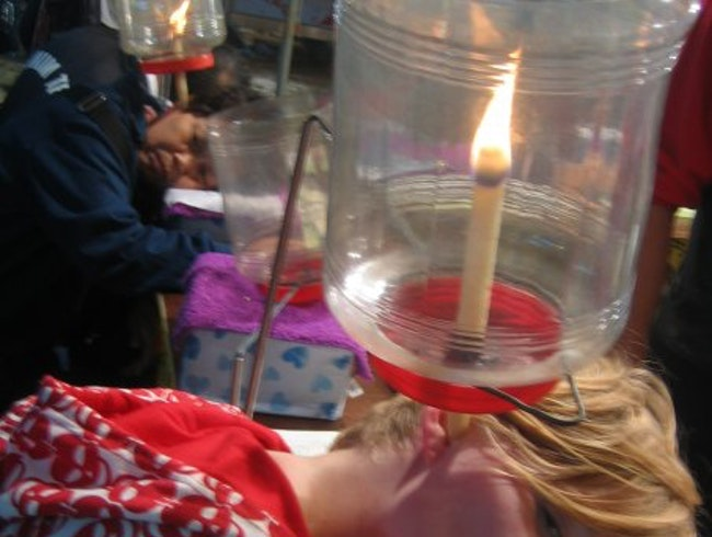 Ear candling on the street!