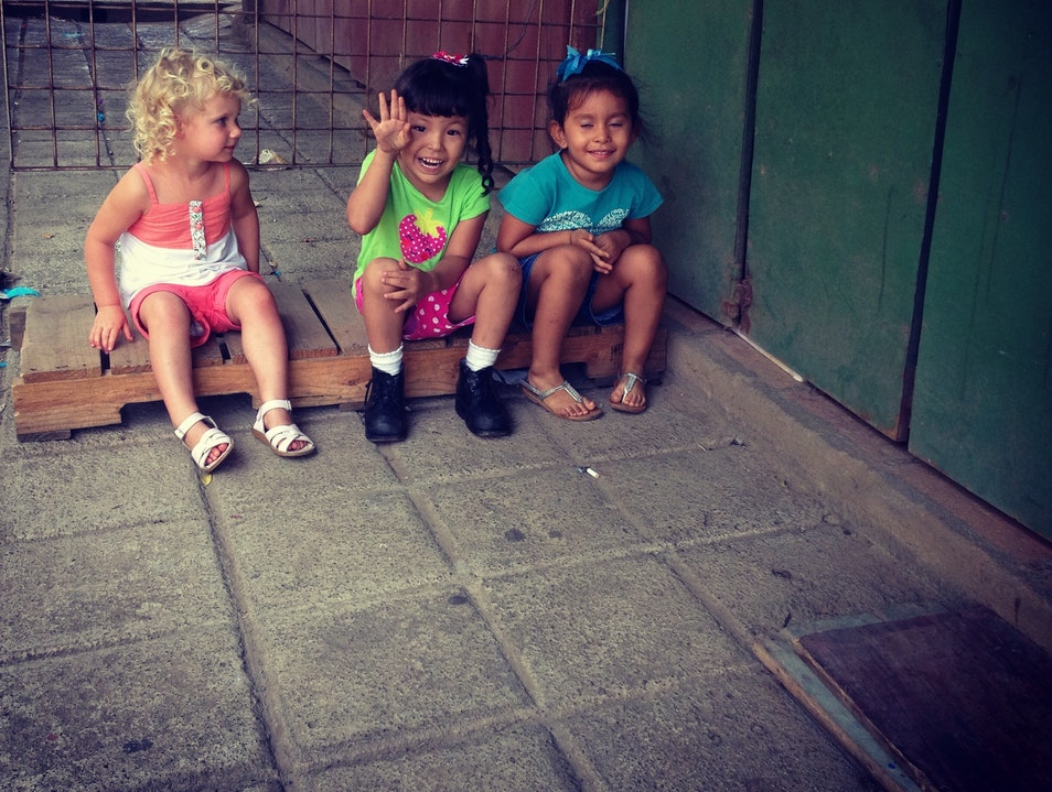 Our daughter making friends on the streets of Nicaragua.