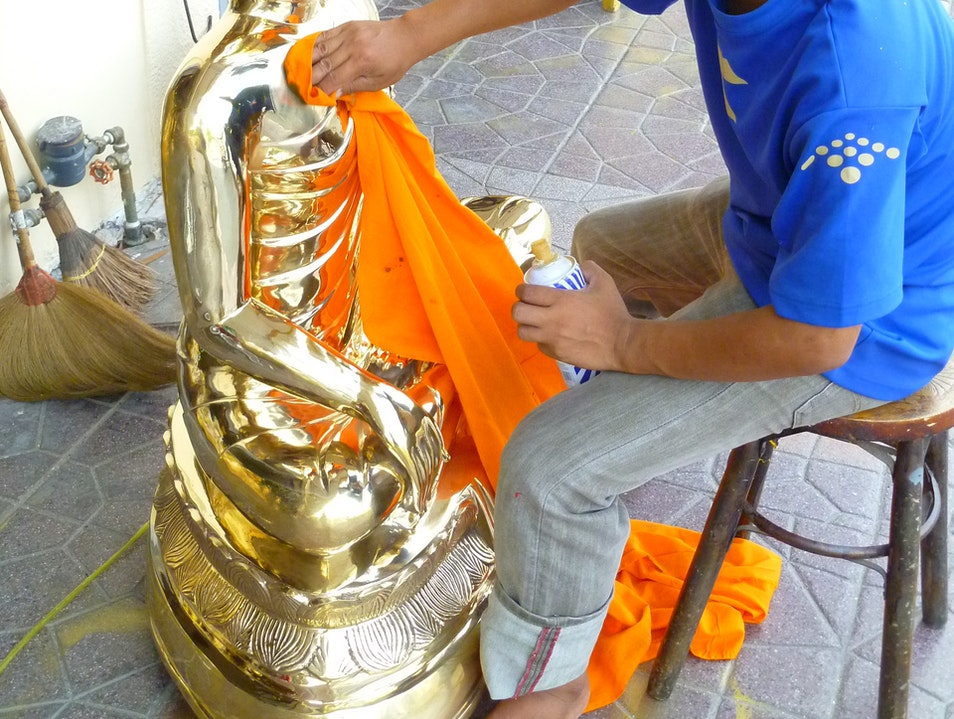 Polishing the Buddha Bangkok  Thailand
