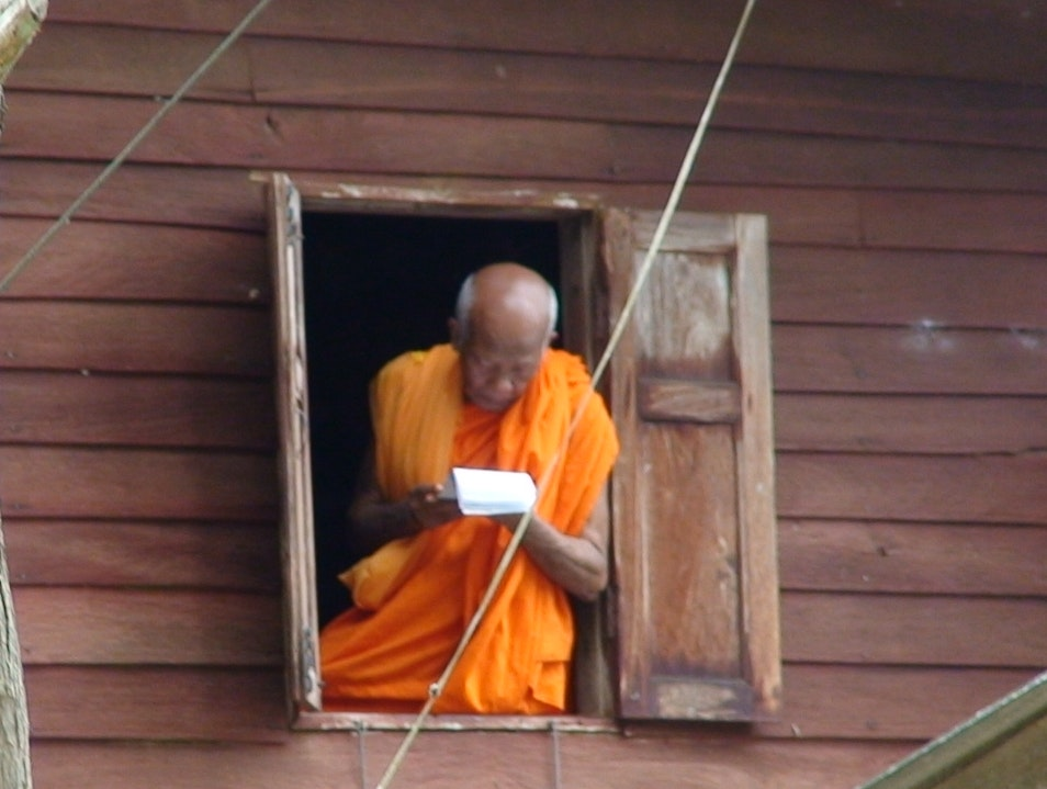Monk in window Khiri Rat Nikhom  Thailand