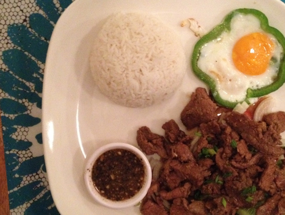 enjoy the best beef lok lak at genevieve's.