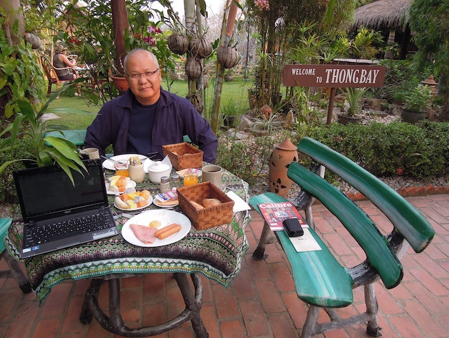 Sumptous Amrican Breakfast at the garden in Thongbay Guesthouse