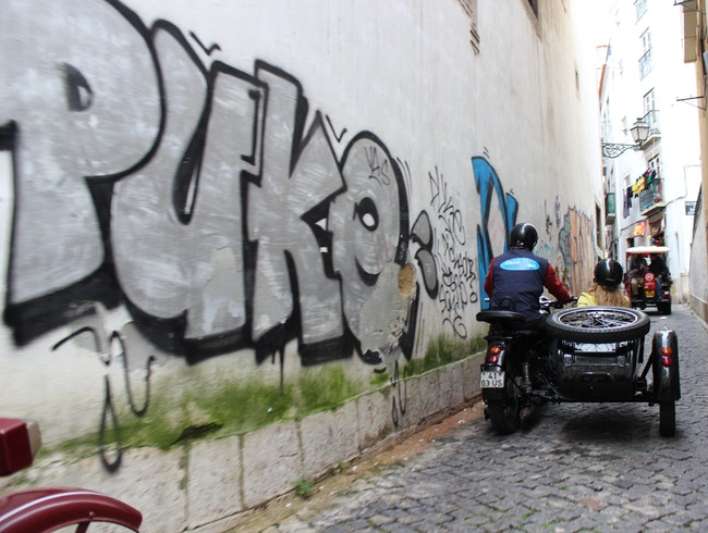 Sidecar Touring Through Lisbon's Narrow Stone Streets
