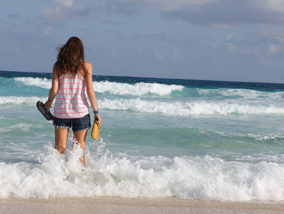 Walking through the waves in Cozumel Quintana Roo  Mexico