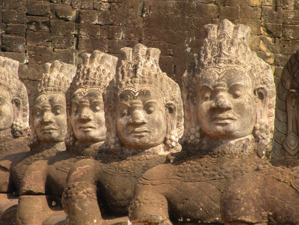 Figures in front of Angkor Siem Reap  Cambodia