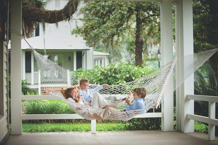 Kids in the hammock; parents at the bar