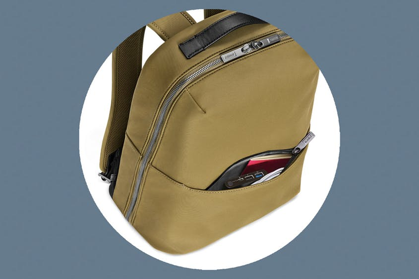 The Small Zip Backpack can fit laptops up to 13 inches; it's available in Black and Brick.