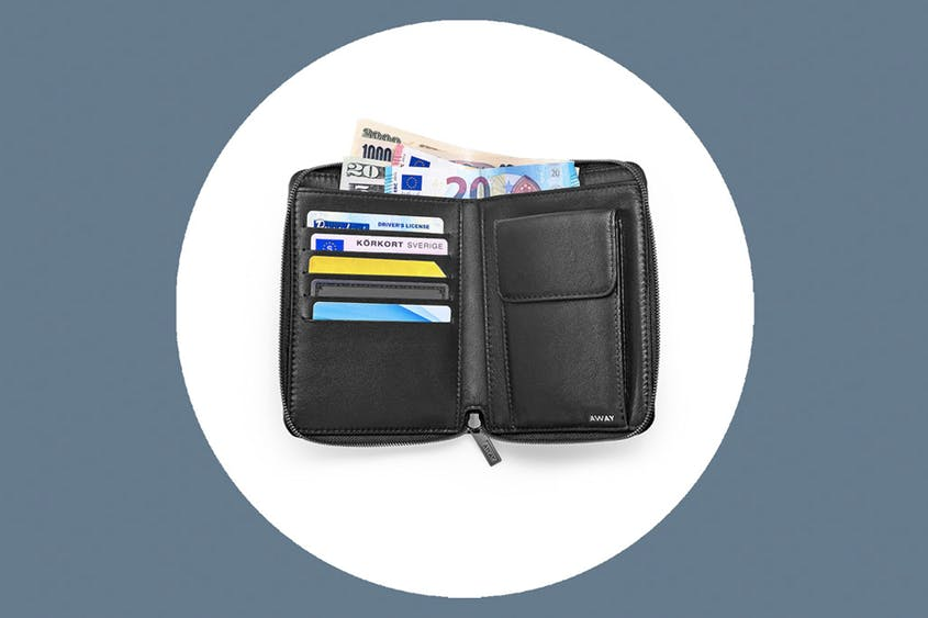 The Zip Around Travel Wallet, sized to fit passports, is available in Black and Coast.