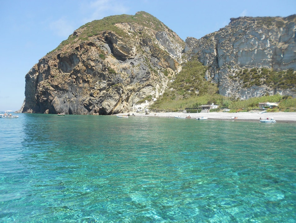 Swim in the crystal-clear waters of Palmarola Ponza  Italy