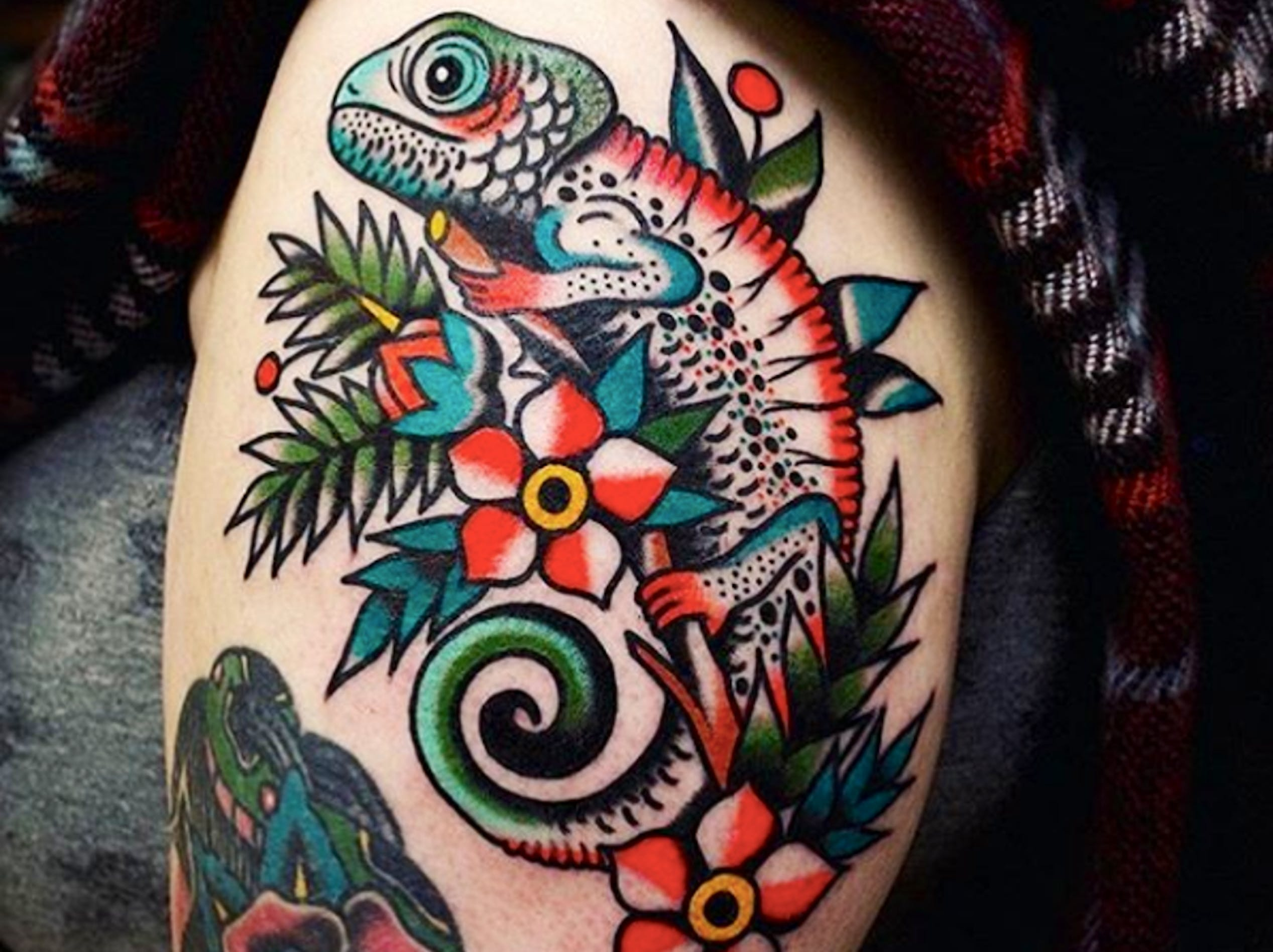 Three Tides Tattoo guest artist Electric Martina uses bold lines and bright colors to make her traditional tattoo style pop.