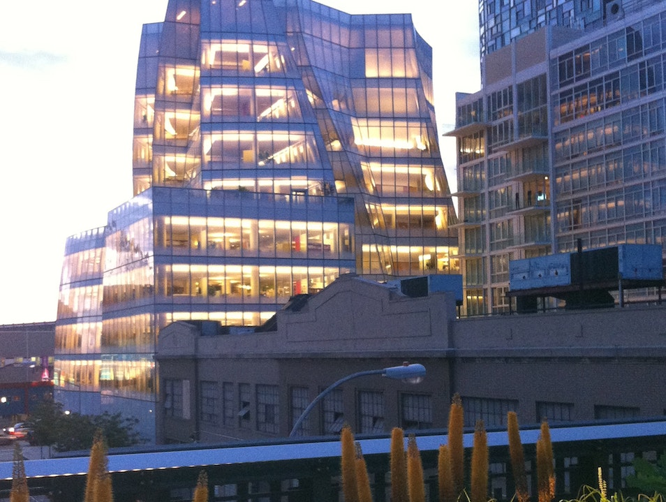 Gehry Building with High Line Flowering Bulbs at Dusk New York New York United States