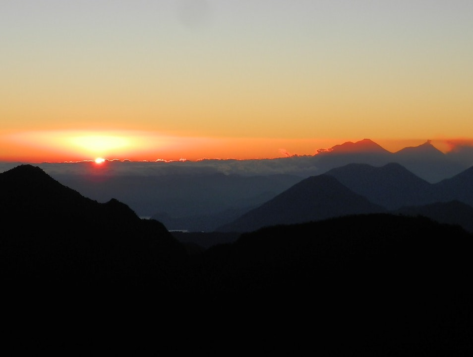 Watching a volcano erupt at sunrise...from the top of another volcano! Santa Maria de Jesus  Guatemala