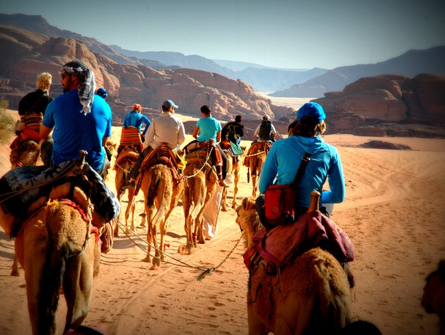 "It's ""Take Your Camel To Work Day"" here in Jordan, as our crew make their way via camel caravan through Wadi Rum."