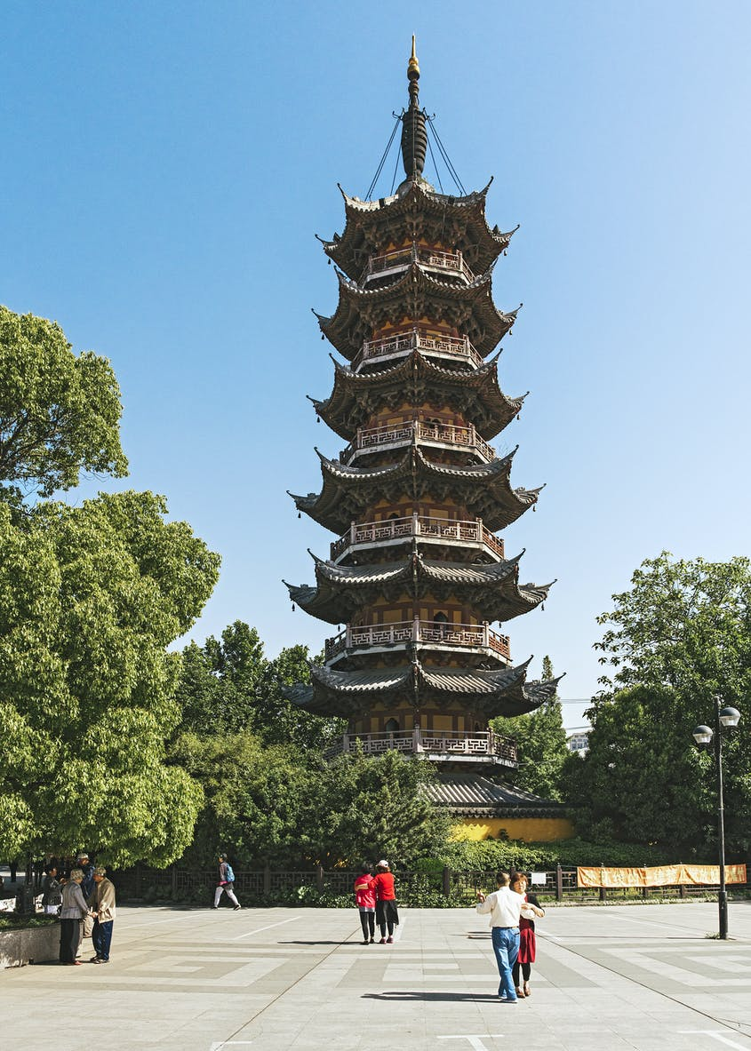 Climbing the tower of the Longhua Temple is a local cultural tradition.