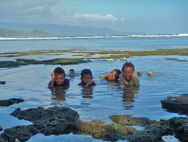 Indonesian Boys Fishing at Low Tide