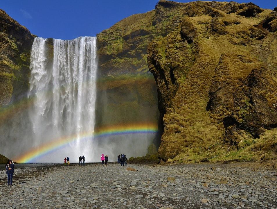 Skogarfoss wrapped in rainbows South  Iceland
