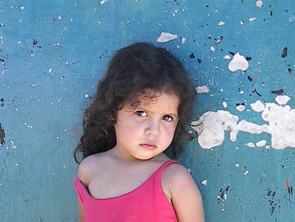 Toddler in Pink against Blue Wall