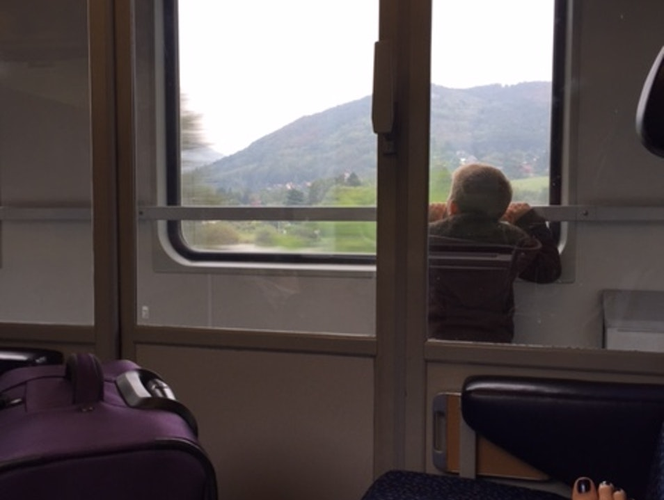 Peering out of a Connecting Train