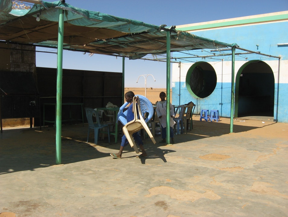 Musical chairs, young boy working hard. Dongola  Sudan