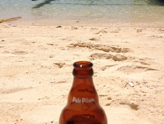 White Sand, A Boat And A Cold San Miguel