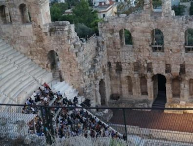 Watch a performance at the Odeion of Herodes Atticus