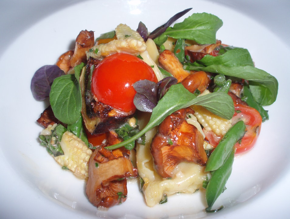 Sweet Corn Agnolotti with Chanterelles, Petit Tomatoes and Field Peas