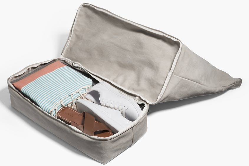 Ignore the fact that these shoes are touching a clean beach towel; at least they're separate from the main clothes compartment in this Lo & Sons weekender bag.