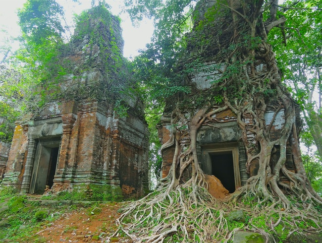 Explore the remote ruins of Koh Ker