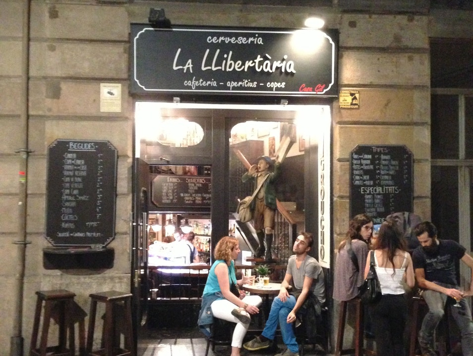 Try an exclusive beer on tap at La Llibertària