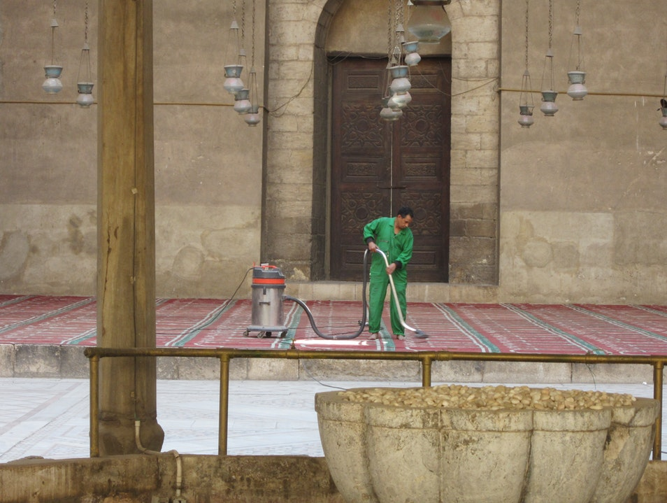 Carpet cleaning at Sultan Hassan Mosque Cairo  Egypt