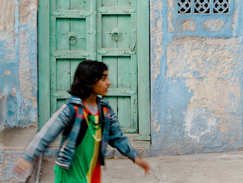 Girl Walking Past Door Jodhpur  India