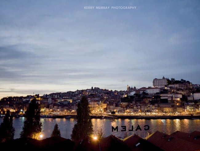 Drinking wine on the banks of the Douro River in Porto, Portugal
