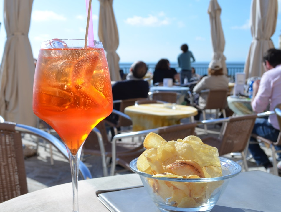 A bar with a sunset view Camogli  Italy