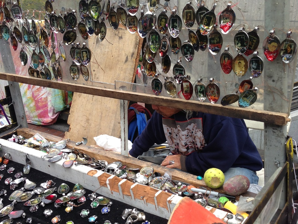 Admire handmade jewelry sold by street vendors San Francisco California United States