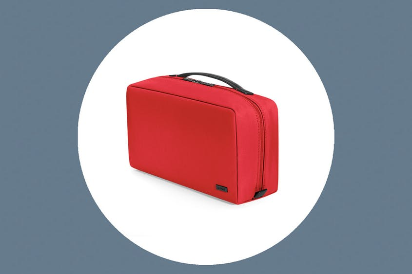The Large Toiletry Bag is available in Black, Coast, Cherry, Green, and Plum.