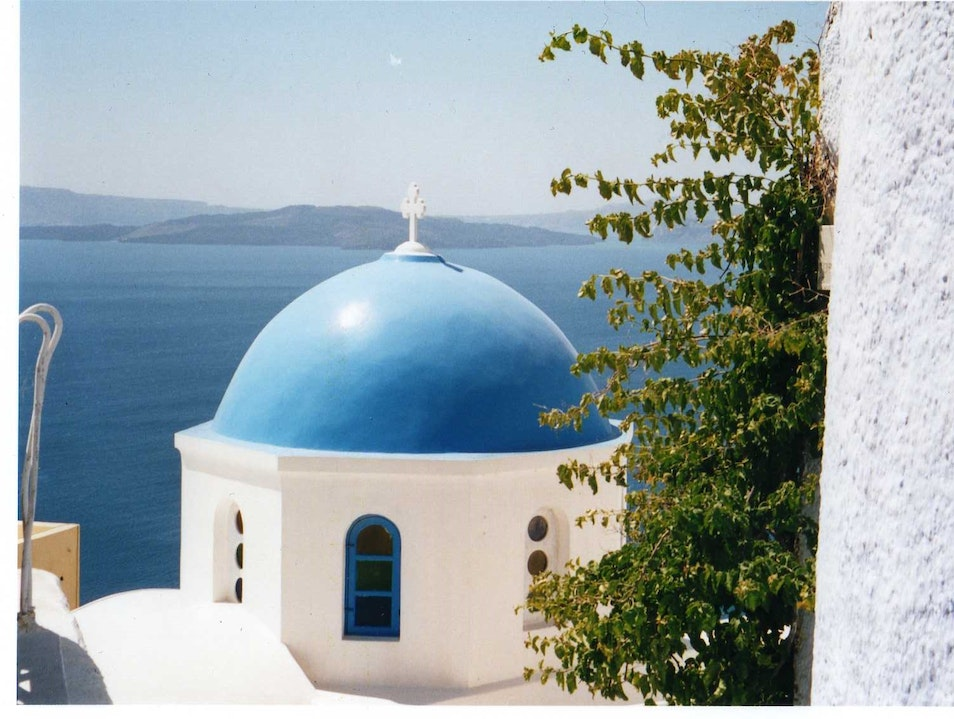Blue-Domed Church in Oia, Santorini Greece Oia  Greece