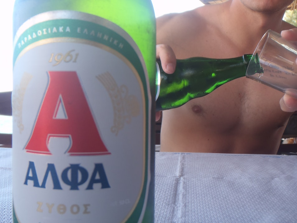 Enjoying an Alpha Beer at Marmara Chania  Greece