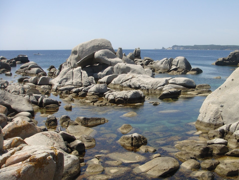 Exploring giant boulders and shaded coves on a natural preserve: Lavezzi Islands