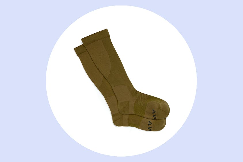 "The Away compression socks come in ""Olive,"" seen here, as well as black and navy."