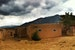 Adobe Under Approaching Rain Taos New Mexico United States