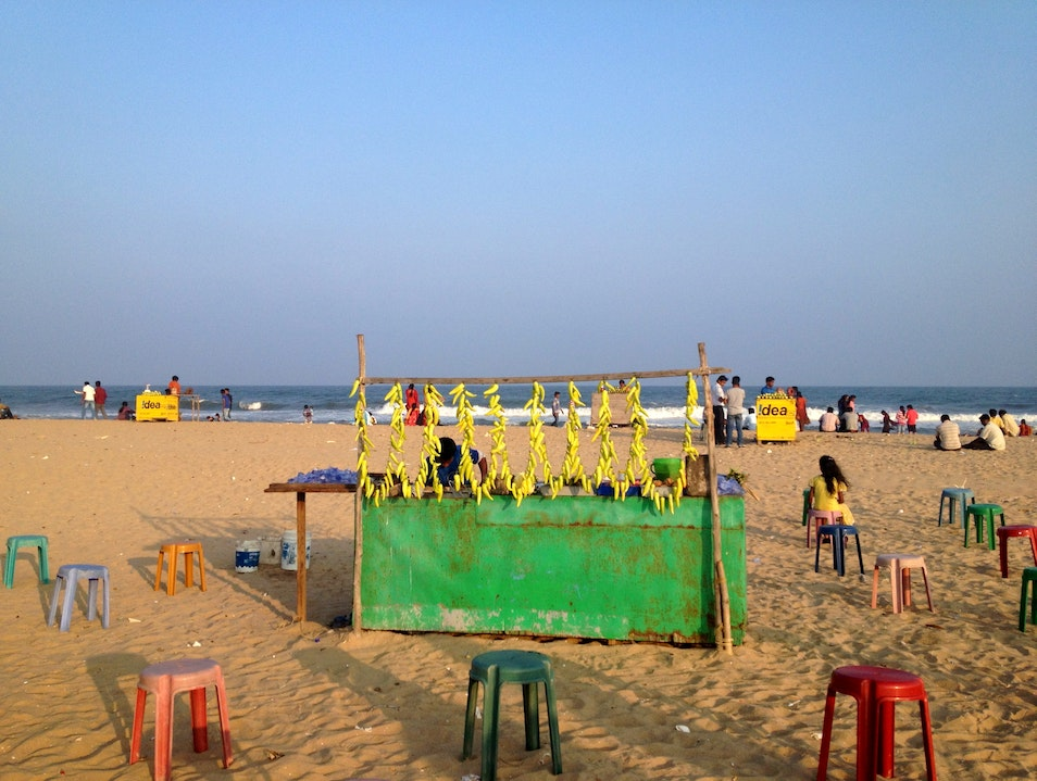 Eating a crispy chilly on the beach Chennai  India