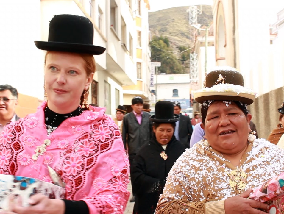 "Dressing up as a ""cholita"" and attending a traditional party Copacabana  Bolivia"