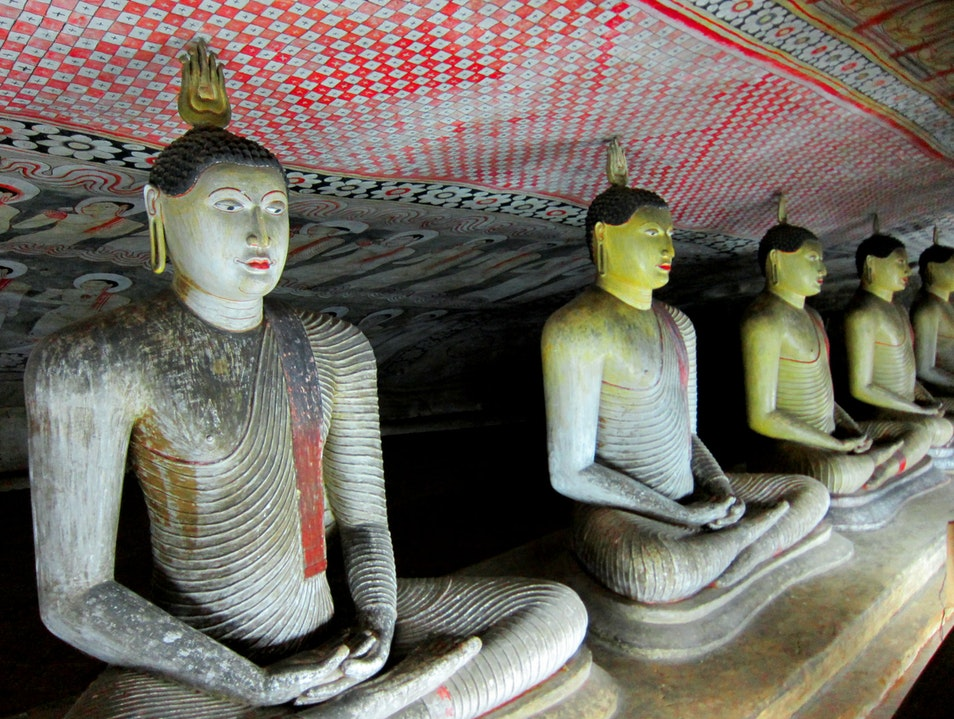 Sitting smiley Buddhas Dambulla  Sri Lanka