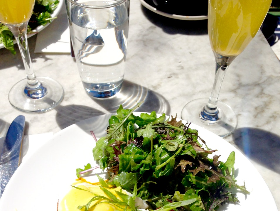 Try the Poached Hollandaise Eggs on a Toasted Croissant at Brooklyn's French Louie