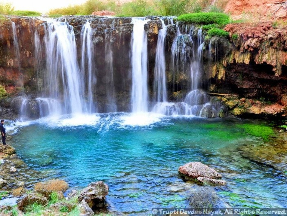 Swimming in the blue-green waters of Havasupai