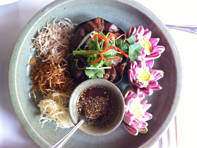 Try the piquant lok lak, Cambodian pepper beef