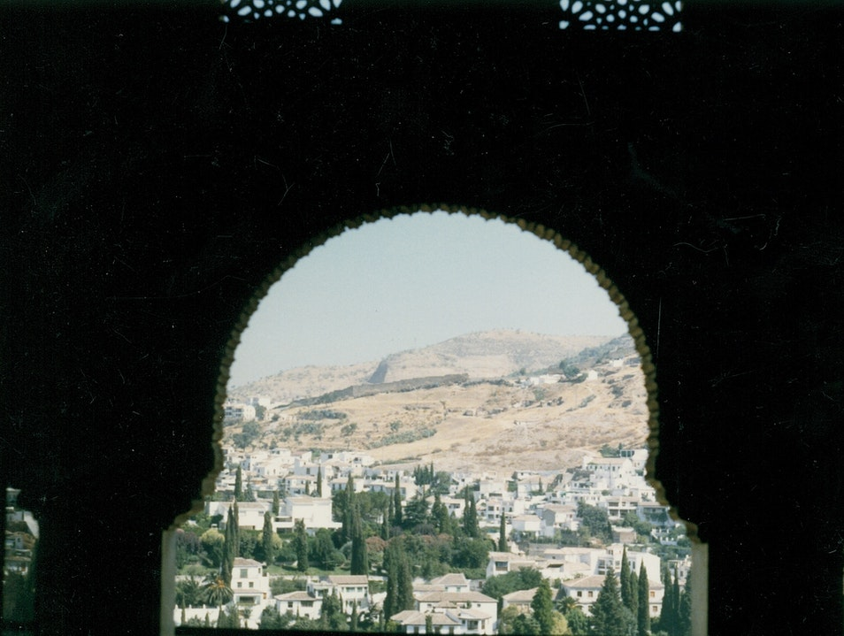 A Glimpse From An Arched Alhambra Window Granada  Spain