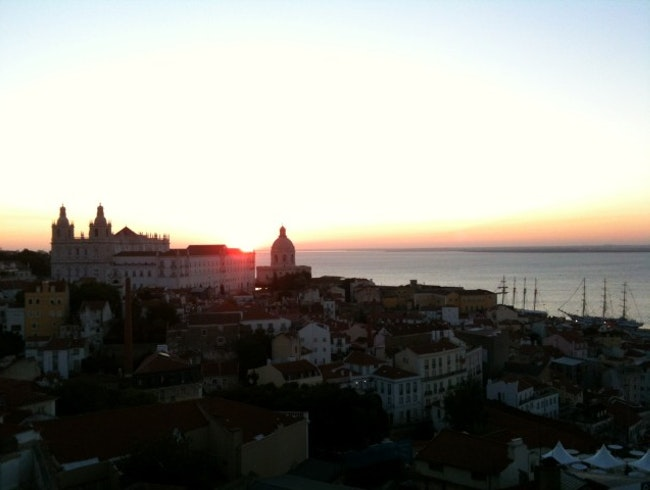 See the sunrise over Alfama